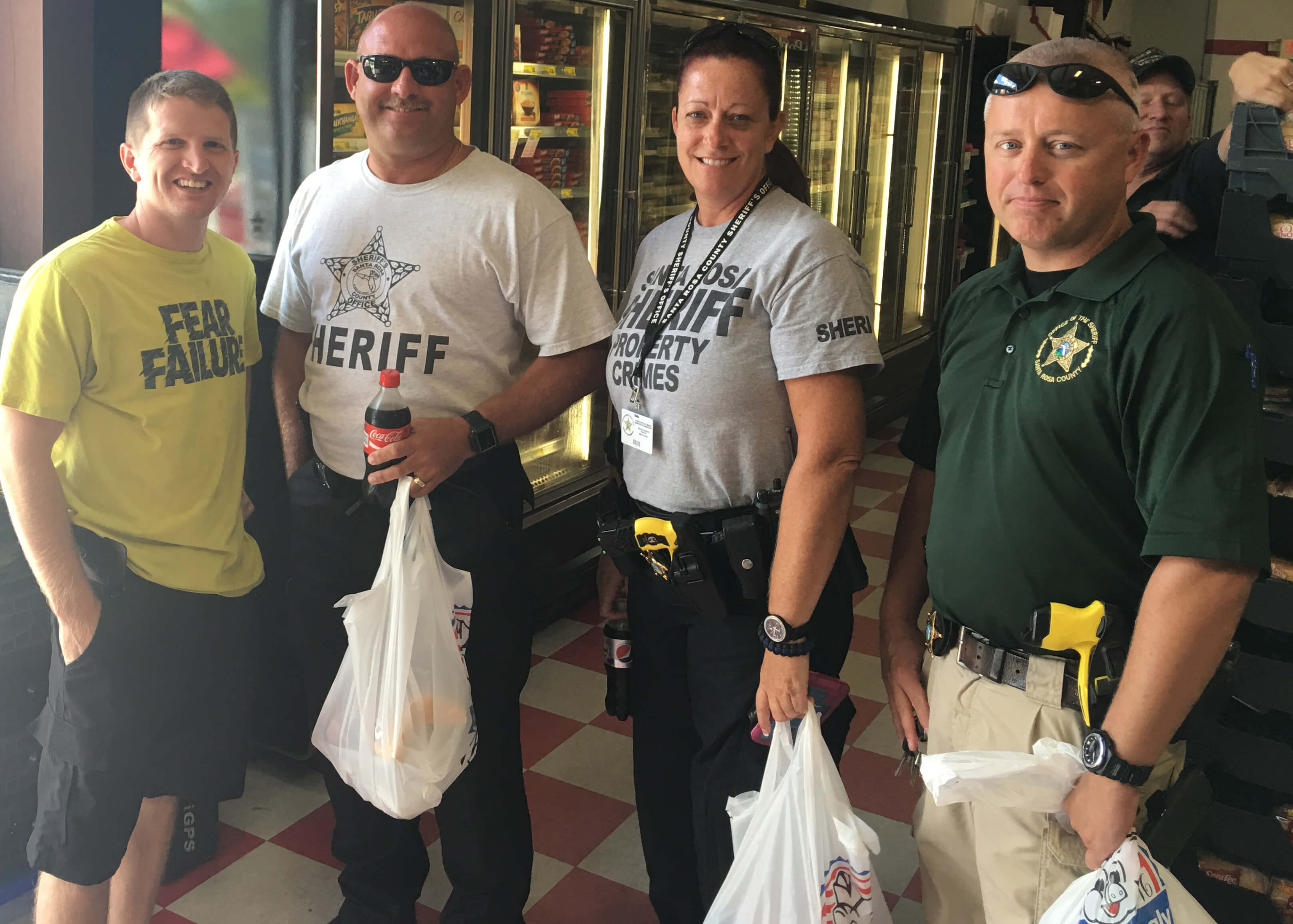 James Raffield and Santa Rosa police officers at Piggly Wiggly